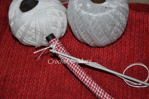 Crocheting singles crochets around the ribbon wrapped tube